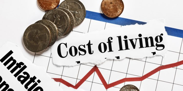 Coins rest on rising graph and cost of living headlines  Inflation rate stays still; measures 10.3% in March inflation 1 750x375