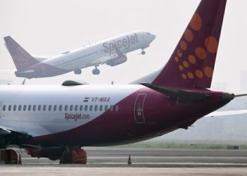 A SpiceJet aircraft takes off as another is pictured on the tarmac at Netaji Subhas Chandra Bose International Airport in Kolkata on October 17, 2019. (Photo by DIBYANGSHU SARKAR / AFP) (Photo by DIBYANGSHU SARKAR/AFP via Getty Images)  Frontier seeks price of $19-21 per share for initial public offering Space Jet 350x250