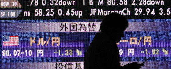 A man walks past a board showing Nikkei stock price index (top) and foreign currency exchange rates outside of a brokerage in Tokyo December 12, 2008. Japanese Finance Minister Shoichi Nakagawa said on Friday that big moves in currency markets were undesirable, adding that he was watching forex market moves with great interest. The dollar tumbled to a 13-year low against the yen on Friday below 90 yen after the U.S. Senate voted down a bailout bill to help U.S. Automakers.     REUTERS/Kim Kyung-Hoon (JAPAN) (Newscom TagID: rtrlthree176412.jpg) [Photo via Newscom] Chinese stocks are now among Asia's worst-performing as Beijing crackdown spooks investors Chinese stocks are now among Asia's worst-performing as Beijing crackdown spooks investors IMF Blog 3