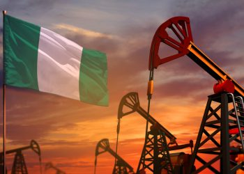 Nigeria oil industry concept, industrial illustration. Nigeria flag and oil wells and the red and blue sunset or sunrise sky background - 3D illustration uae and saudi compromise; what is in it for nigeria? UAE and Saudi compromise; what is in it for Nigeria? nigerian oil 350x250