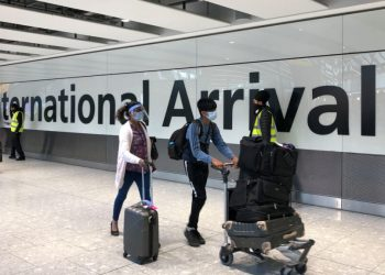 LONDON, ENGLAND - APRIL 23: Passengers are escorted through the arrivals area of terminal 5 towards coaches destined for quarantine hotels, after landing at Heathrow airport on April 23, 2021 in London, England. From 4am this morning, passengers landing in the UK from India are now required to stay in isolation at government-approved hotels for ten days, in a bid to prevent the spread of a new strain of the COVID-19 virus. Indian health services are currently struggling to fight soaring infection rates and a rapidly-rising death toll. (Photo by Leon Neal/Getty Images) Unilever Ghana emerges sole gainer on GSE at end of trading session on Tuesday Unilever Ghana emerges sole gainer on GSE at end of trading session on Tuesday Heathrow Arrivals 1024x576 1 350x250
