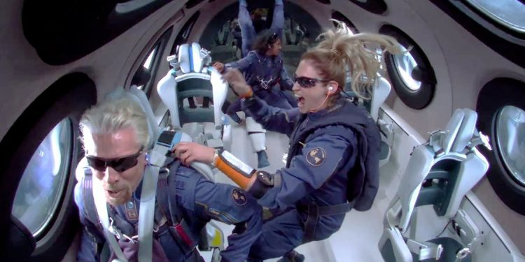 Billionaire Richard Branson makes a statement as crew members Beth Moses and Sirisha Bandla float in zero gravity on board Virgin Galactic's passenger rocket plane VSS Unity after reaching the edge of space above Spaceport America near Truth or Consequences, New Mexico, U.S. July 11, 2021 in a still image from video.    Virgin Galactic/Handout via REUTERS.  NO RESALES. NO ARCHIVES. THIS IMAGE HAS BEEN SUPPLIED BY A THIRD PARTY. Virgin space flight tickets to start at $450,000 Virgin space flight tickets to start at $450,000 richard branson in space reuters 1626066205947 750x375