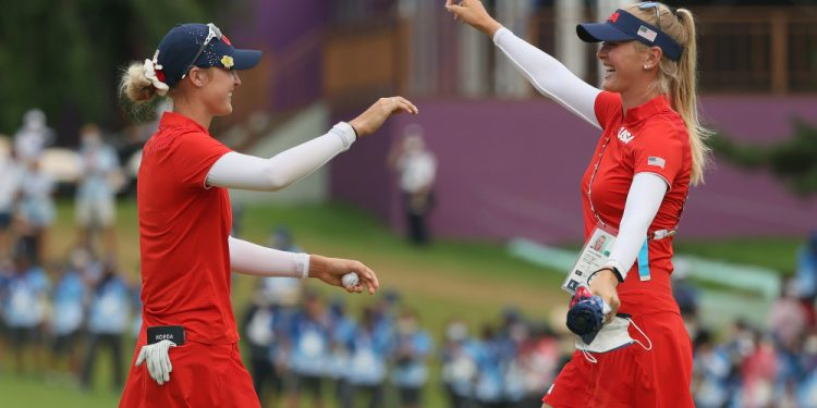 KAWAGOE, JAPAN - AUGUST 07: (L-R) Nelly Korda of Team United States celebrates with her sister Jessica Korda of Team United States after Nelly secured the gold medal on the 18th green during the final round of the Women's Individual Stroke Play on day fifteen of the Tokyo 2020 Olympic Games at Kasumigaseki Country Club on August 07, 2021 in Kawagoe, Japan. (Photo by Mike Ehrmann/Getty Images) Solheim Cup 2021: Team Europe defeat Team USA 15-13 to claim historic victory on away soil Solheim Cup 2021: Team Europe defeat Team USA 15-13 to claim historic victory on away soil 1332796195 750x375