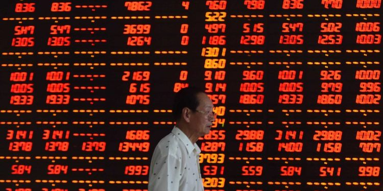 10 Jul 2015, Shenyang, Liaoning Province, China --- (150710) -- SHENYANG, July 10, 2015 (Xinhua) -- An investor walks at a securities firm in Shenyang, northeast China's Liaoning Province, July 10, 2015. Chinese shares staged a two-day strong rebound after intensive moves by the government to bolster the market. The benchmark Shanghai Composite Index leaped 4.54 percent to finish at 3,877.8 points on Friday. The Shenzhen Component Index surged 4.59 percent to close at 12,038.15points. (Xinhua/Pan Yulong) (wf) --- Image by © Pan Yulong/Xinhua Press/Corbis China set to open new stock exchange in Beijing China set to open new stock exchange in Beijing china stock market 750x375